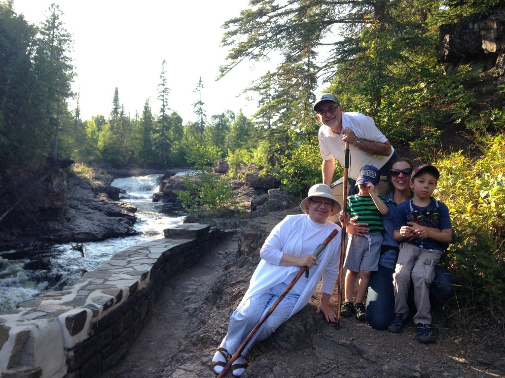 Heart Ball chair Ahmed Elmouelhi as a young child posing with his family next to a waterfall on the North Shore