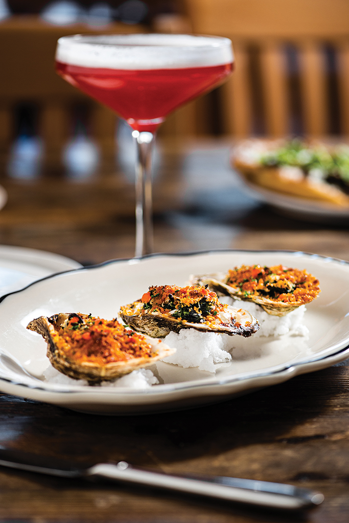 Estelle's baked oysters with a Showdown in Tangletown cocktail
