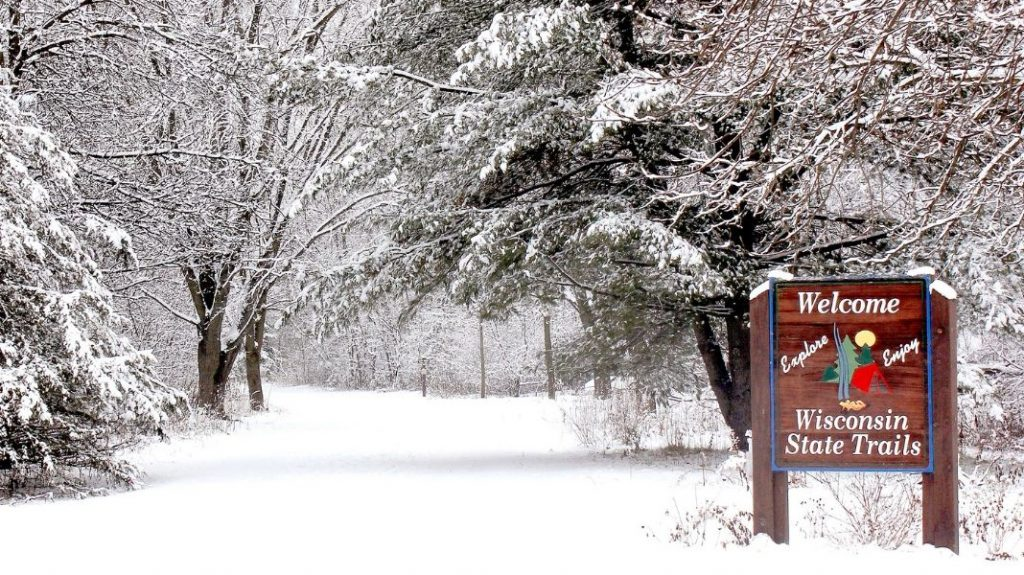 """A snowy path and a sign that says """"Wisconsin State Trails"""" at Hoffman Hills State Recreation Area in Menomonie, Wisconsin"""