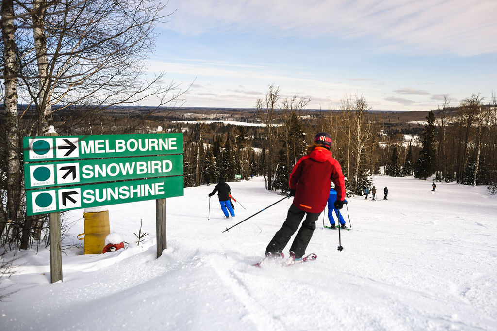 People downhill skiing at Giants Ridge on the Iron Range in Minnesota
