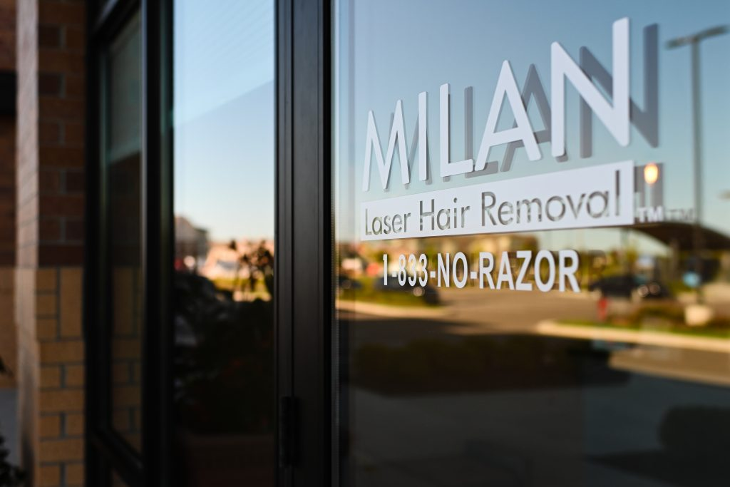 A door with Milan Laser Hair Removal etched on the front.