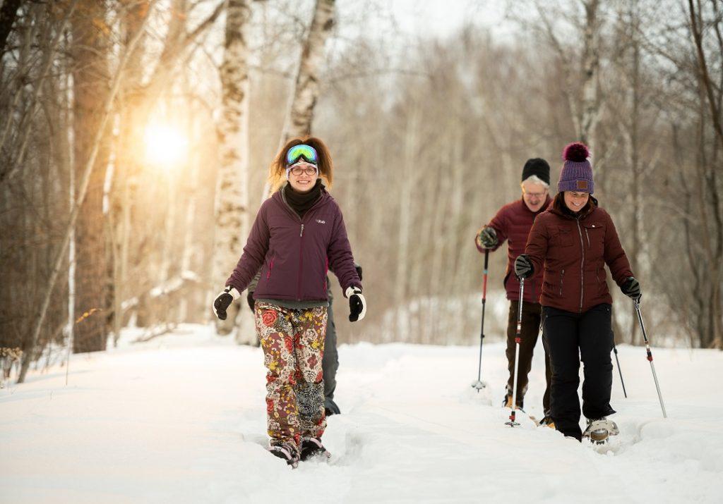 Four adults snowshoeing on the Mesabi Iron Range in Minnesota