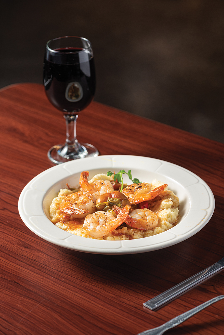 Jerk spiced jumbo shrimp served on smoked Gouda grits with Creole sauce and pickled sport peppers