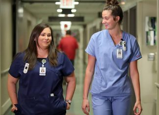 UND student Amy Joshua walking down corridor at Altru Health System with another nurse