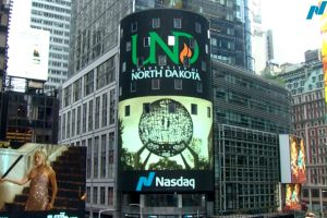 UND banner logo broadcasted on the Nasdaq sign in Times Square