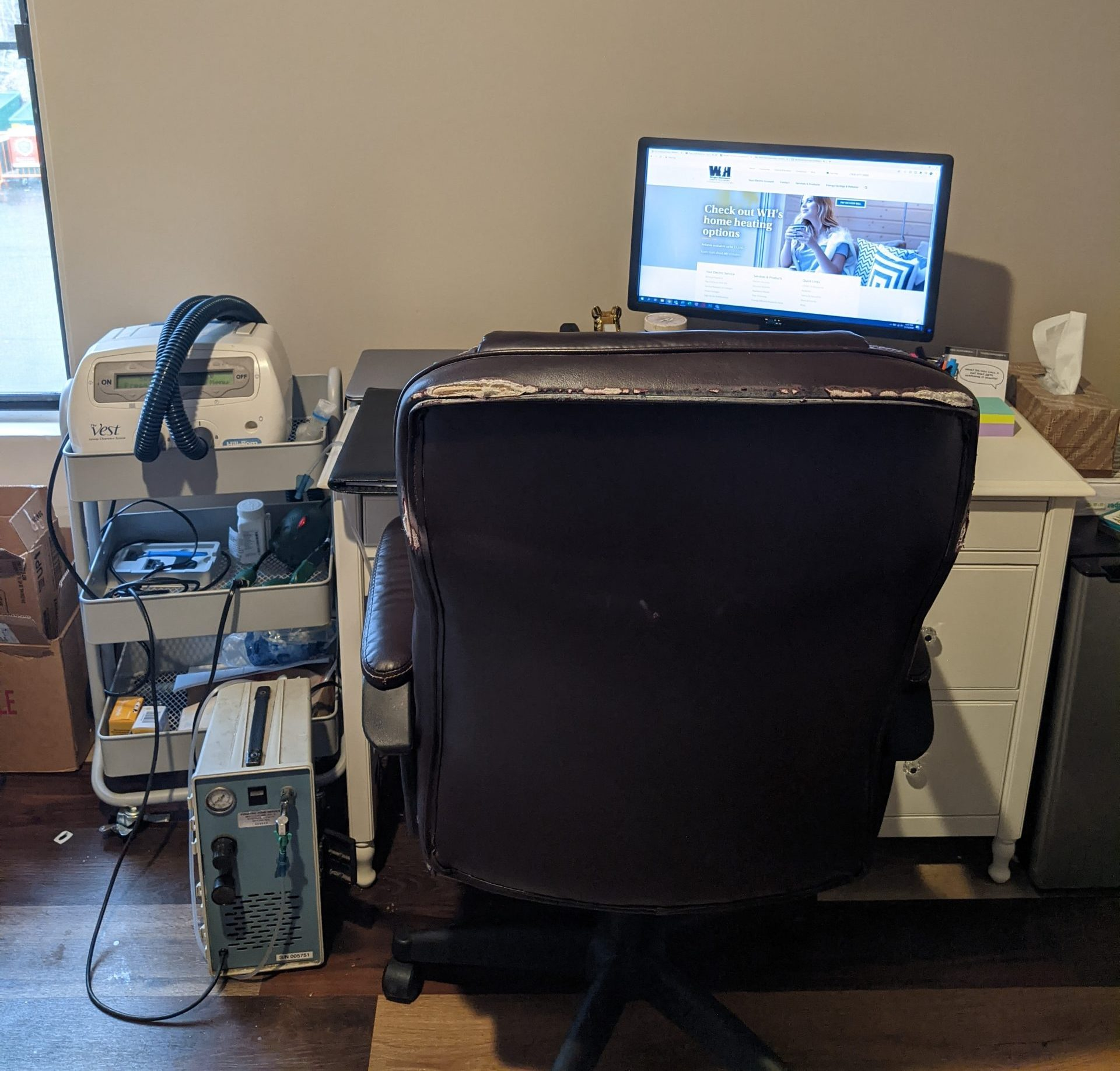 My work-from-home setup: computer, desk, medical equipment all next to each other