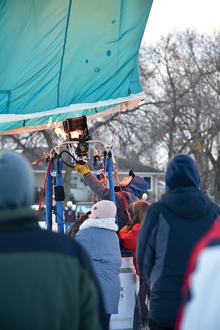 Feel the burn: Spectators at Hot Air Affair 2020 gather near a balloon burner's open flame