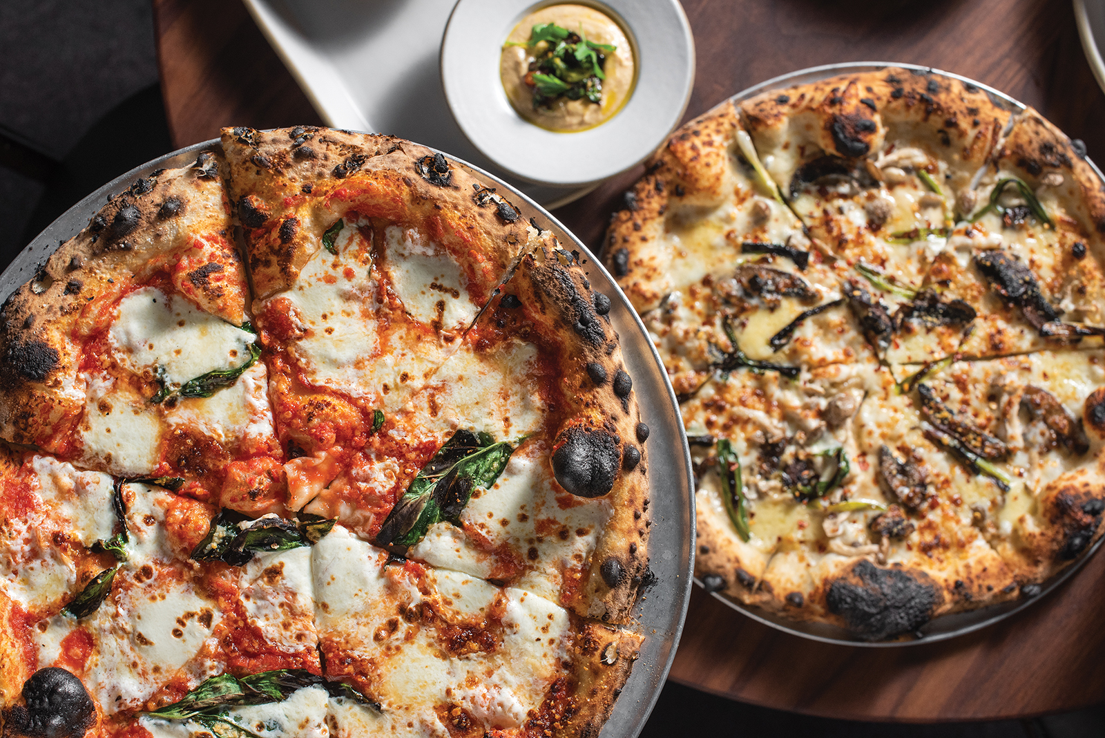 Margherita and funghi wood-fired pizzas