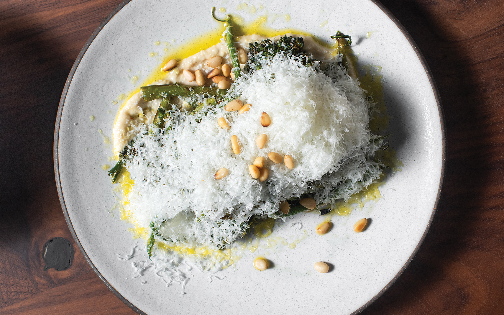 Roasted broccolini with pine nut tahini, toasted pine nuts, green chermoula, and pecorino