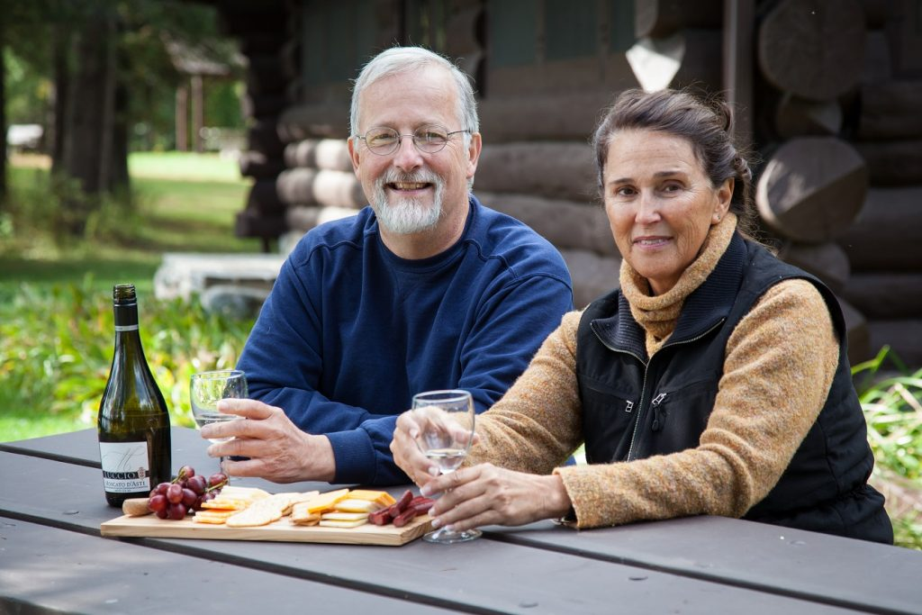Couple sitting on a picnic table