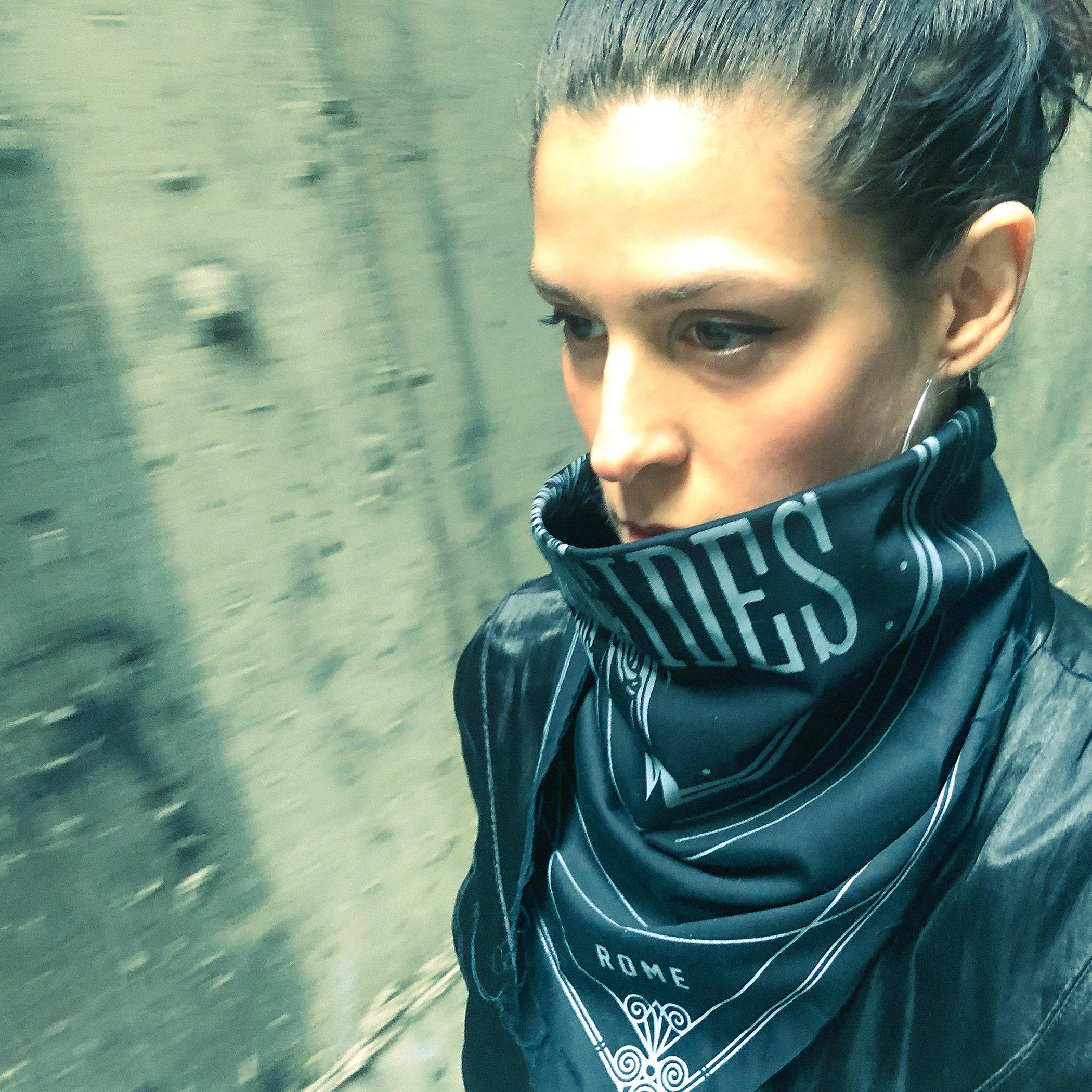 "Selfie of Dessa wearing an ""IDES"" bandana over her mouth."