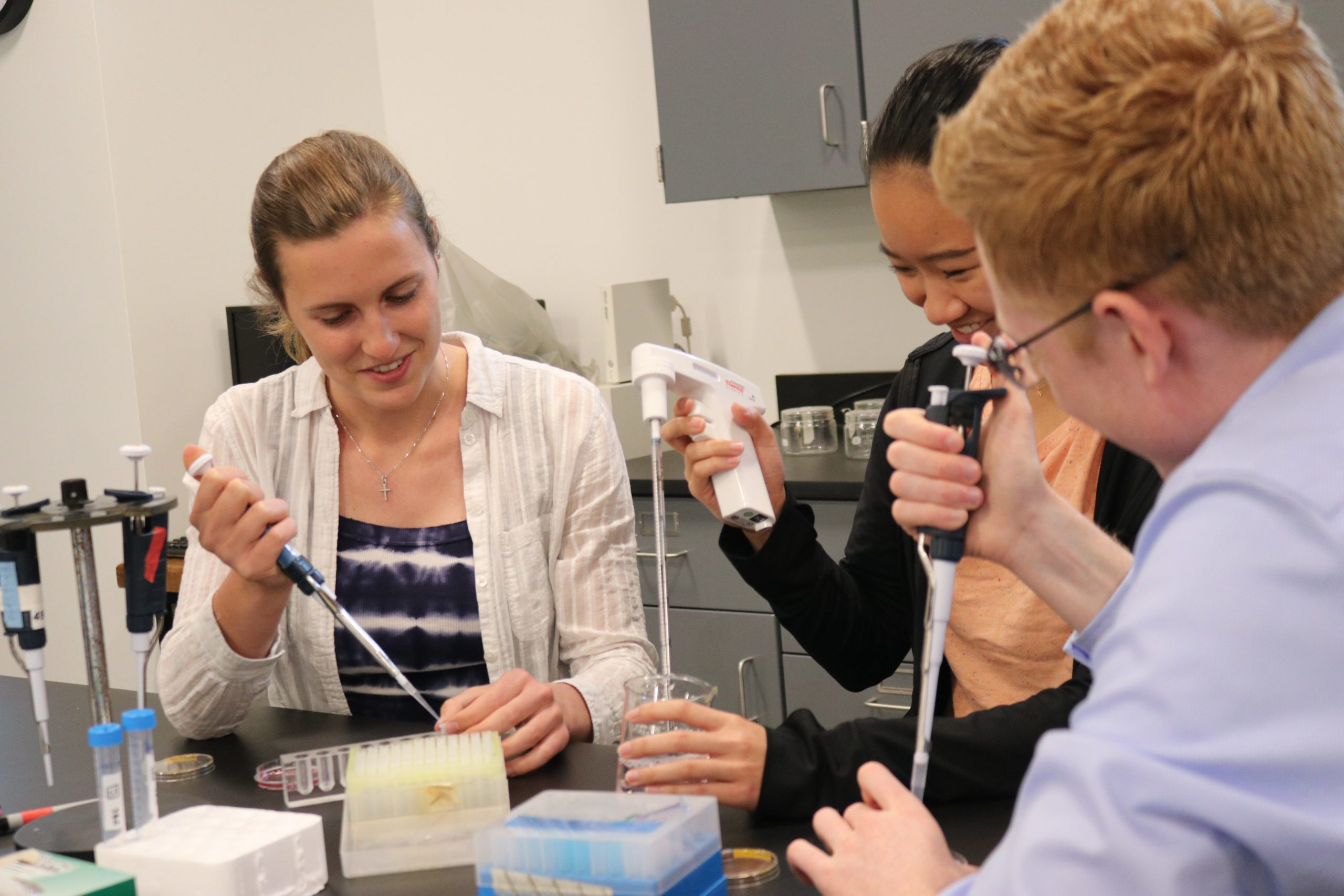 Three students working in a science lab at the Winona campus of Saint Mary's University of Minnesota.