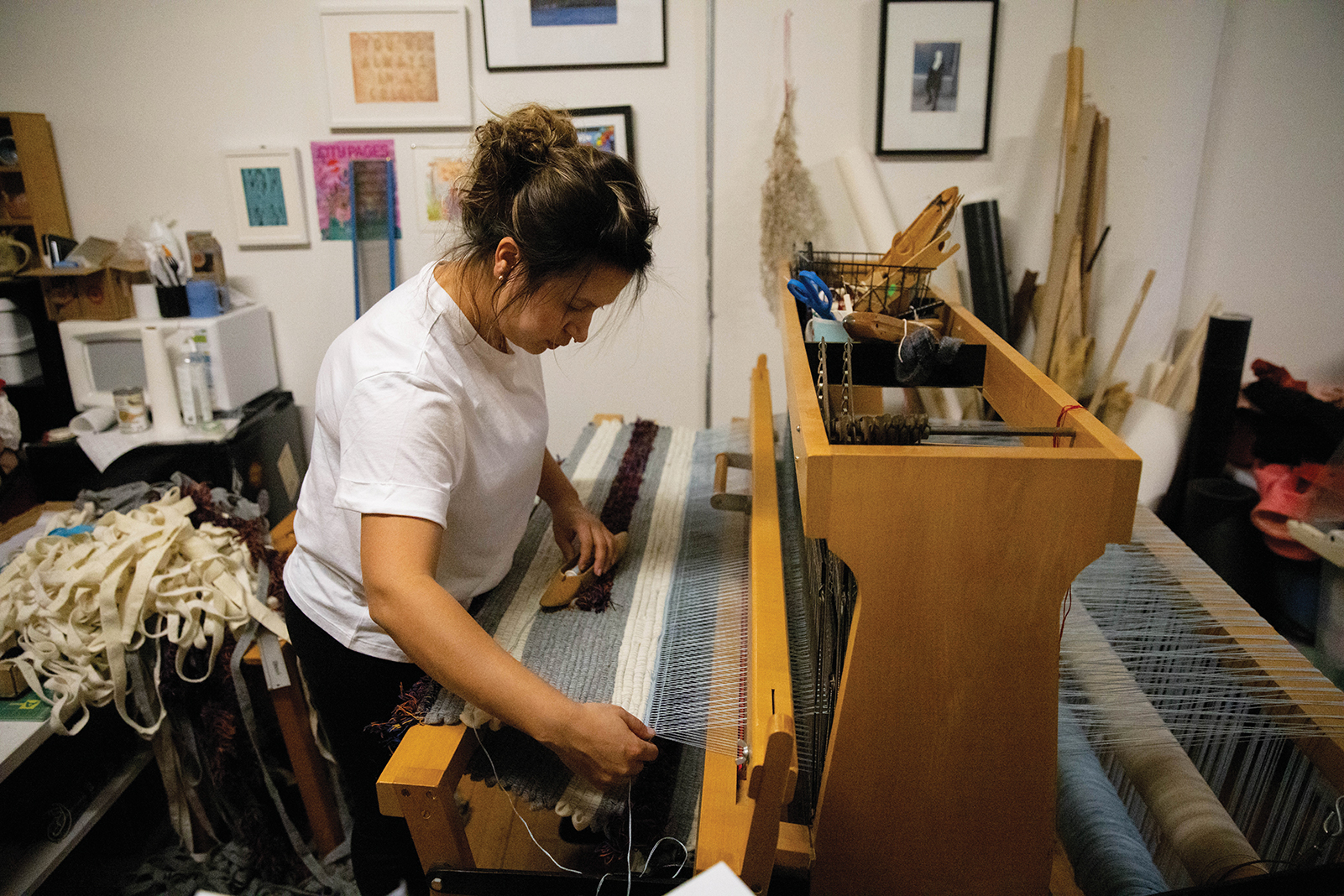 Maggie Thompson in her Minneapolis studio, where she has lately made face masks decorated with ribbons