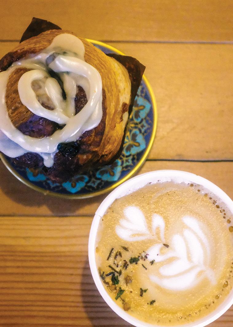 A cinnamon roll with a Dukkah latte