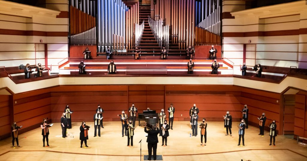 A group of people rehearsing for the VocalEssence concert