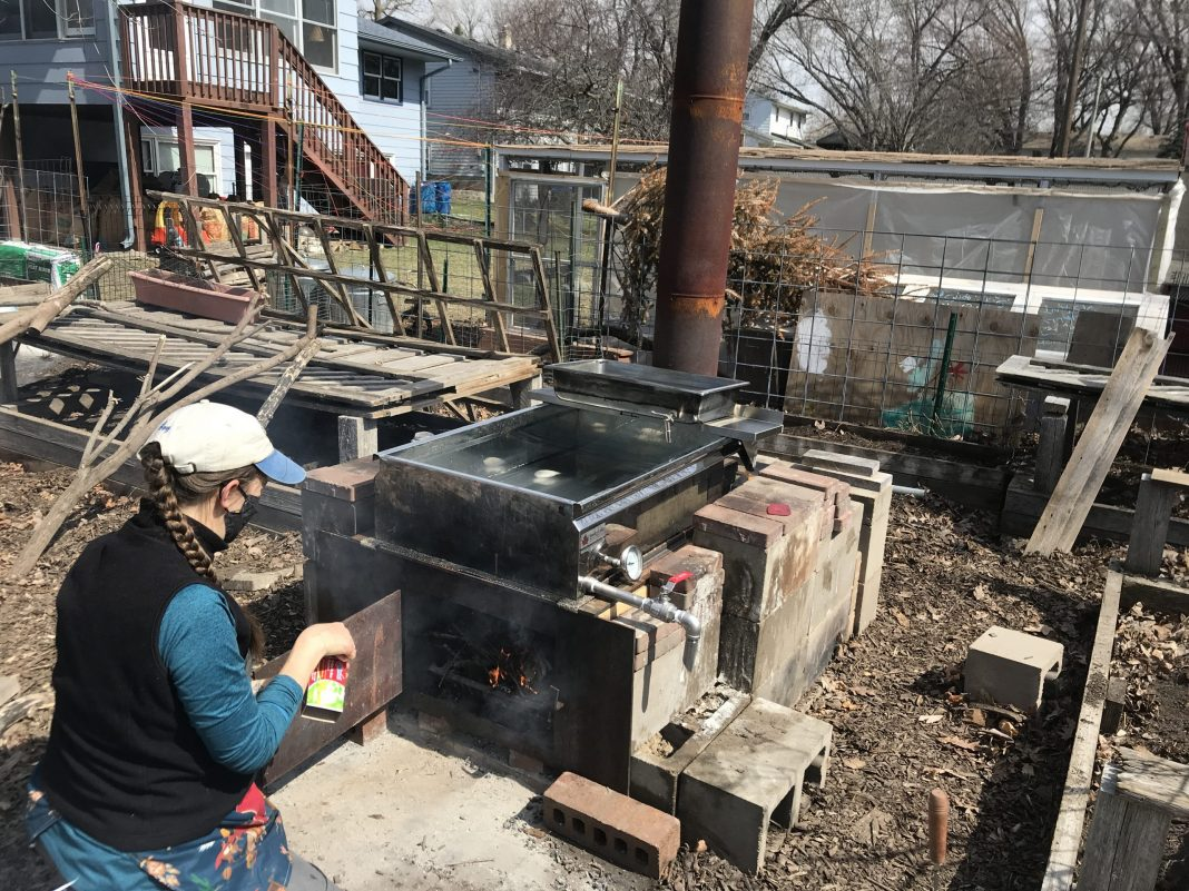 Amy Perkins makes maple syrup out of tree sap in her backyard