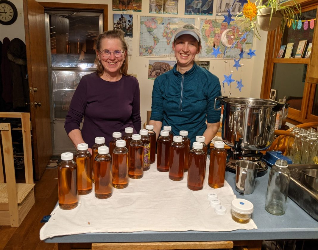 Amy Perkins (right) and a friend with the last batch of the year