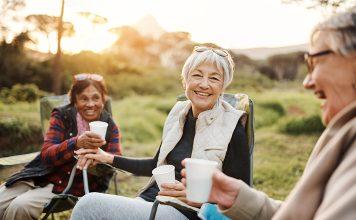 Three women enjoying a beverage at Applewood Pointe