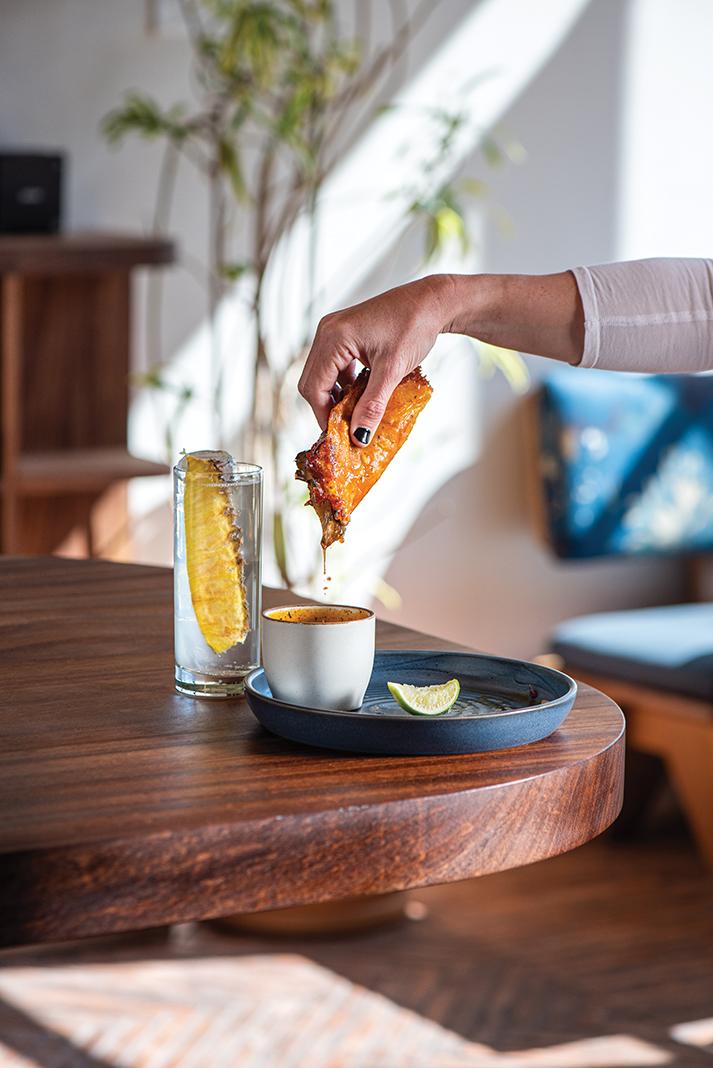 Birria with maitake mushroom, queso chihuahua, and shitake crema, served with umami-rich consommé—plus a glass of house-made tepache