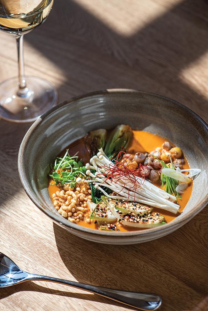Soup inspired by Mexican pozole and Korean doenjang with potawatomi flint corn, puffed rice, chayote, bok choy, shungiku, and enoki
