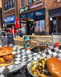 A burger on the patio at 7West Taphouse