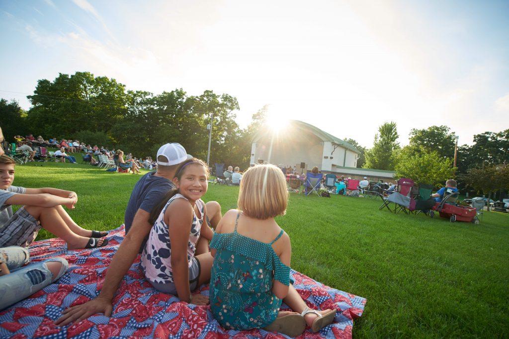 Three people sitting at Halfway Creek Park