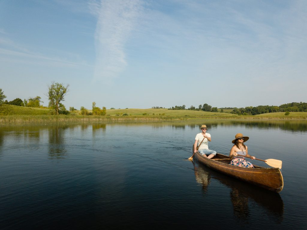 A man and a woman paddling on the Chain of Lakes