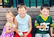 Three kids eating Knoke's ice cream in Hudson, Wisconsin