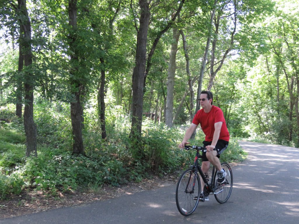 A man biking on the the Willmar Lakes Area Trails