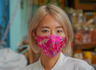 A woman wearing a pink face mask