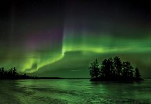 The northern lights dance above Cranberry Bay in the upper reaches of Voyageurs National Park