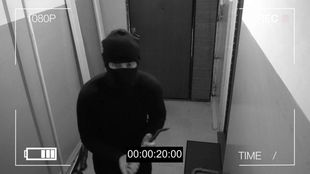 Surveillance footage of a burglar