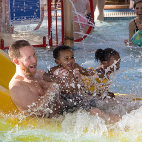 A family having fun at a waterslide in Twin Cities Gateway