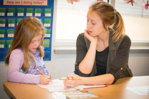 A teacher helping a student at the Christian Heritage Academy