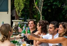 A group of friends enjoying a Peroni drink