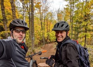 Two men take selfies as they bike the Tioga Recreation Area in Grand Rapids