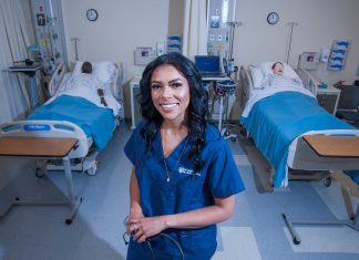 A woman standing in a hospital