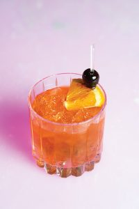 A Nucky's old fashioned on the lit-up bar